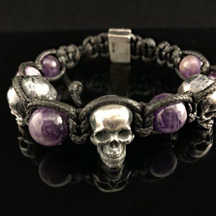 Плетеный браслет с 3 черепами серебро